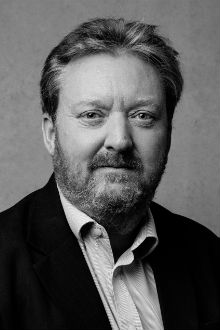 Black and white headshot of Audio Network company founder and chairman, Andrew Sunnucks