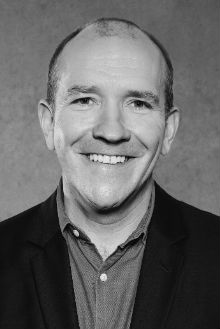 Black and white headshot of Audio Network's Global Commercial Director, Andy Williams