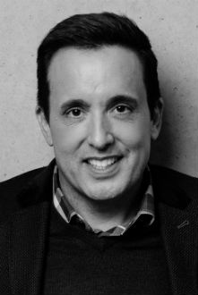 Black and white headshot of Audio Network's Chief Marketing Officer, Patrick Alo