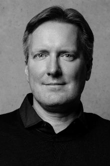 Black and white headshot of Audio Network founder Robb Smith