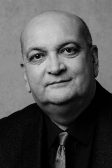 Black and white headshot of Audio Network founder, Robert Hurst