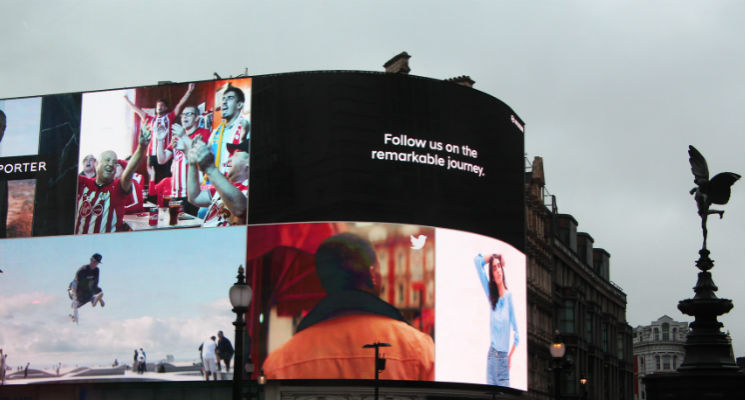 large digital advertising billboard with multiple commercials screened at one time